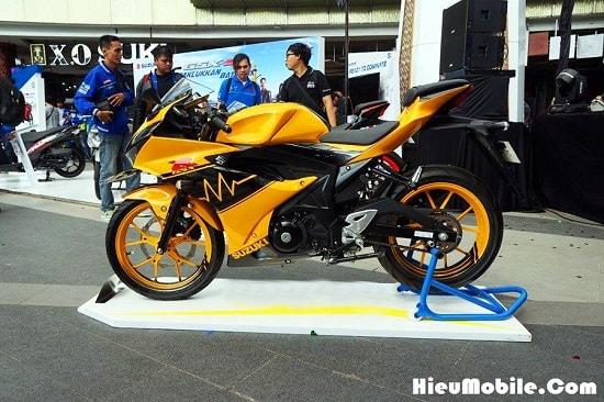 Hình ảnh Vi7TMuW của Suzuki giới thiệu mẫu GSX R150 tem cam đen cực chất tại HieuMobile